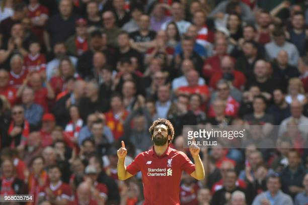 TOPSHOT Liverpool's Egyptian midfielder Mohamed Salah celebrates after scoring during the English Premier League football match between Liverpool and...