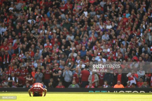 Liverpool's Egyptian midfielder Mohamed Salah celebrates after scoring during the English Premier League football match between Liverpool and...