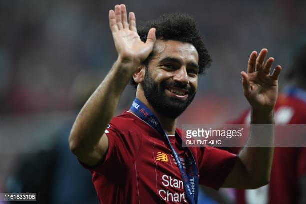 Liverpool's Egyptian midfielder Mohamed Salah celebrates after Liverpool won the UEFA Super Cup 2019 football match between FC Liverpool and FC...