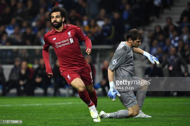 Liverpool's Egyptian midfielder Mohamed Salah celebrates past Porto's Spanish goalkeeper Iker Casillas after scoring his team's second goal during...