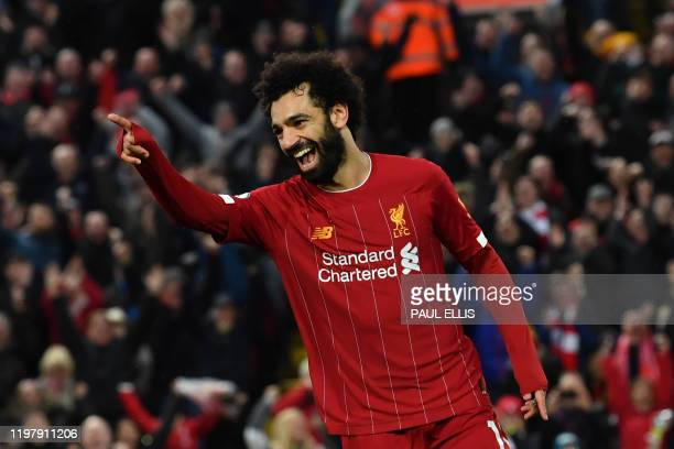 Liverpool's Egyptian midfielder Mohamed Salah celebrates scoring his team's fourth goal during the English Premier League football match between...
