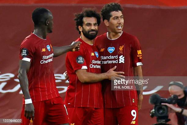 Liverpool's Egyptian midfielder Mohamed Salah celebrates scoring his team's second goal with Liverpool's Senegalese striker Sadio Mane and...
