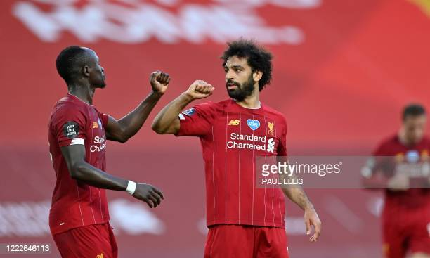 Liverpool's Egyptian midfielder Mohamed Salah celebrates scoring his team's second goal with Liverpool's Senegalese striker Sadio Mane during the...