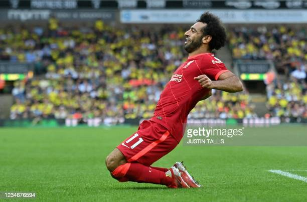Liverpool's Egyptian midfielder Mohamed Salah celebrates scoring his team's third goal during the English Premier League football match between...