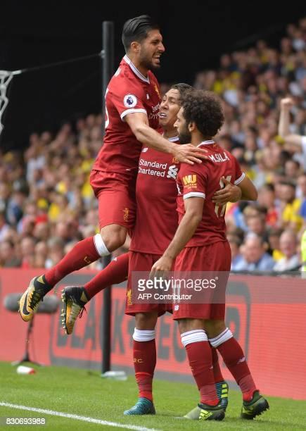 Liverpool's Egyptian midfielder Mohamed Salah celebrates scoring his team's third goal with Liverpool's Brazilian midfielder Roberto Firmino and...