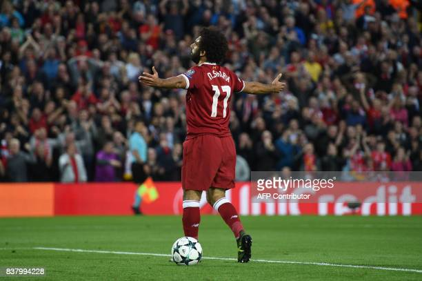 Liverpool's Egyptian midfielder Mohamed Salah celebrates scoring his team's second goal during the Champions League qualifier second leg match...