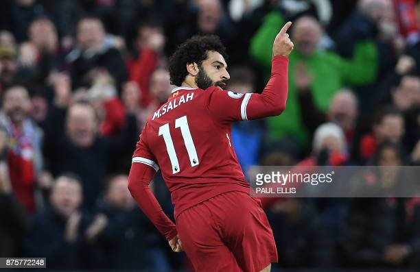 Liverpool's Egyptian midfielder Mohamed Salah celebrates scoring his team's first goal during the English Premier League football match between...