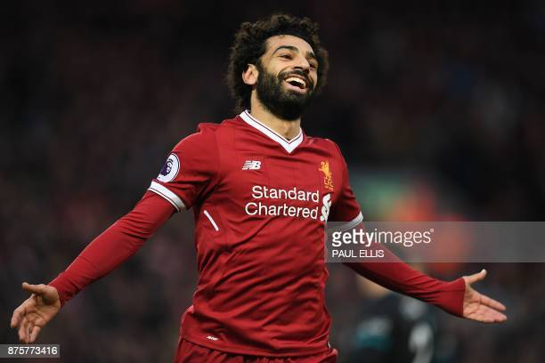 Liverpool's Egyptian midfielder Mohamed Salah celebrates scoring his team's second goal during the English Premier League football match between...