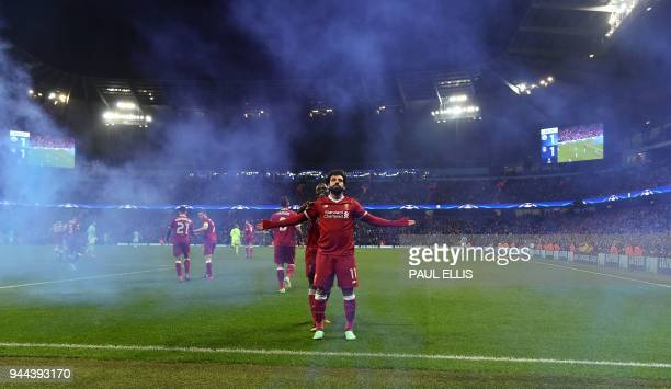 Liverpool's Egyptian midfielder Mohamed Salah celebrates scoring his team's first goal during the UEFA Champions League second leg quarterfinal...