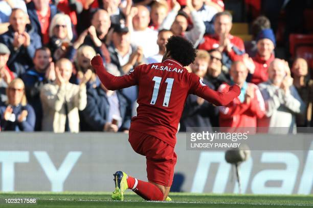 Liverpool's Egyptian midfielder Mohamed Salah celebrates scoring the opening goal during the English Premier League football match between Liverpool...