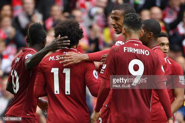 Liverpool's Egyptian midfielder Mohamed Salah celebrates scoring the team's third goal during the English Premier League football match between...