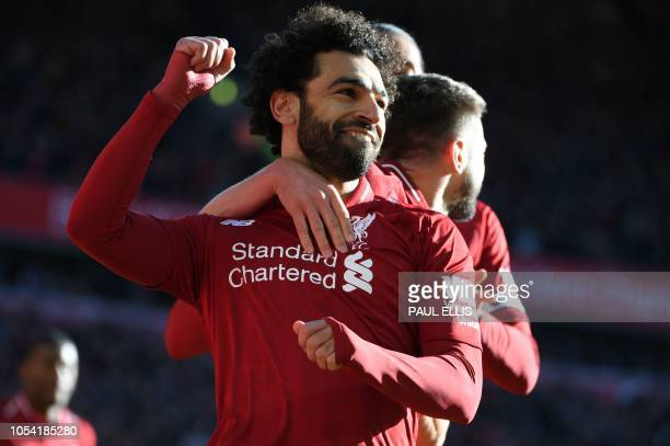 TOPSHOT Liverpool's Egyptian midfielder Mohamed Salah celebrates scoring the opening goal with Liverpool's English midfielder Adam Lallana during the...