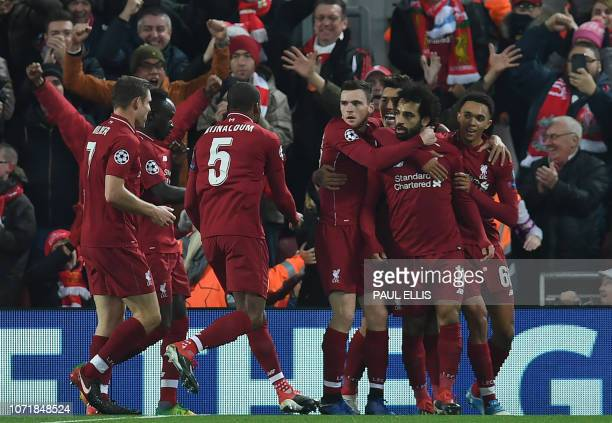 Liverpool's Egyptian midfielder Mohamed Salah celebrates scoring the opening goal during the UEFA Champions League group C football match between...