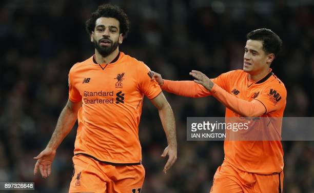 Liverpool's Egyptian midfielder Mohamed Salah celebrates scoring the second goal with Liverpool's Brazilian midfielder Philippe Coutinho during the...
