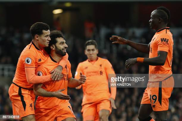 Liverpool's Egyptian midfielder Mohamed Salah celebrates scoring the team's second goal with Liverpool's Brazilian midfielder Philippe Coutinho and...