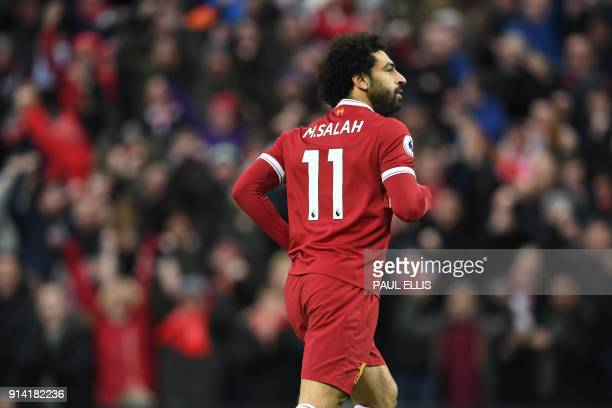 Liverpool's Egyptian midfielder Mohamed Salah celebrates scoring the team's first goal during the English Premier League football match between...