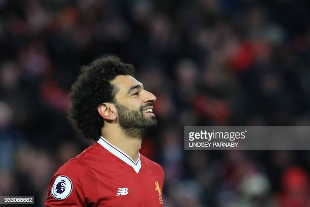 Liverpool's Egyptian midfielder Mohamed Salah celebrates scoring the team's second goal during the English Premier League football match between...