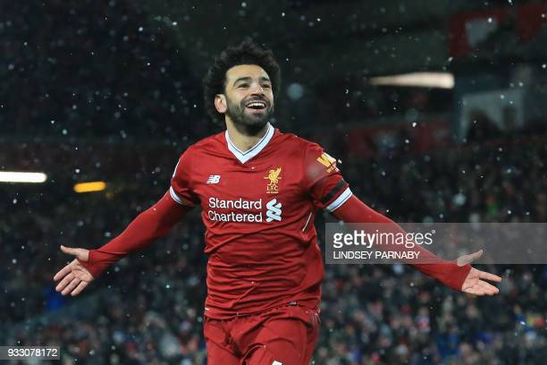 Liverpool's Egyptian midfielder Mohamed Salah celebrates scoring the team's fourth goal during the English Premier League football match between...