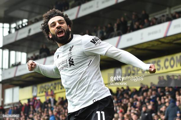 TOPSHOT Liverpool's Egyptian midfielder Mohamed Salah celebrates scoring the team's second goal during the English Premier League football match...