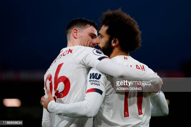 Liverpool's Egyptian midfielder Mohamed Salah celebrates scoring their third goal with Liverpool's Scottish defender Andrew Robertson during the...