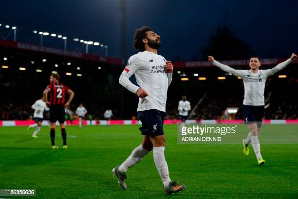 Liverpool's Egyptian midfielder Mohamed Salah celebrates scoring their third goal during the English Premier League football match between...