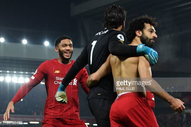 Liverpool's Egyptian midfielder Mohamed Salah celebrates scoring their second goal with Liverpool's English defender Joe Gomez and Liverpool's...