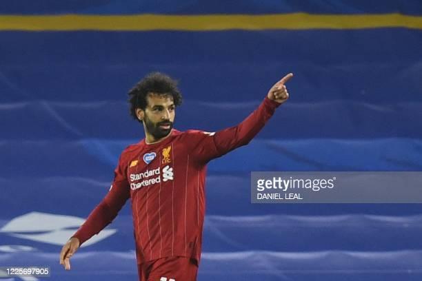 Liverpool's Egyptian midfielder Mohamed Salah celebrates scoring their third goal during the English Premier League football match between Brighton...