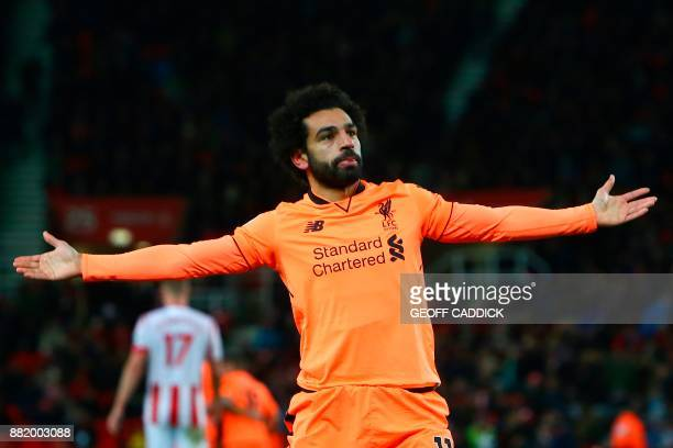 Liverpool's Egyptian midfielder Mohamed Salah celebrates scoring their third goal during the English Premier League football match between Stoke City...