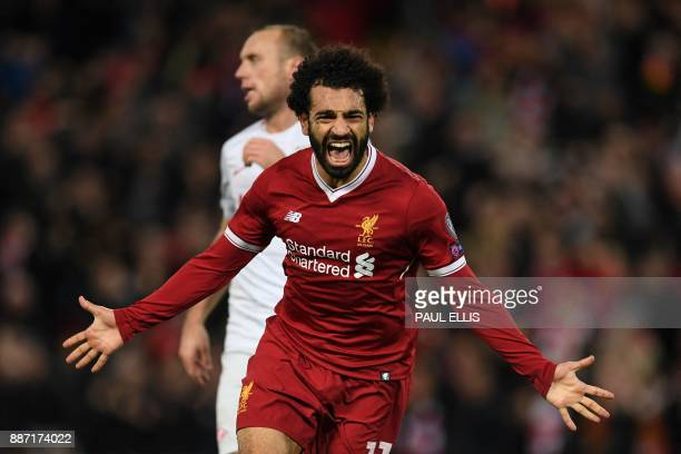 Liverpool's Egyptian midfielder Mohamed Salah celebrates scoring their seventh goal during the UEFA Champions League Group E football match between...