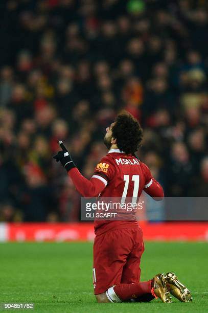 Liverpool's Egyptian midfielder Mohamed Salah celebrates scoring their fourth goal to make the score 41 during the English Premier League football...
