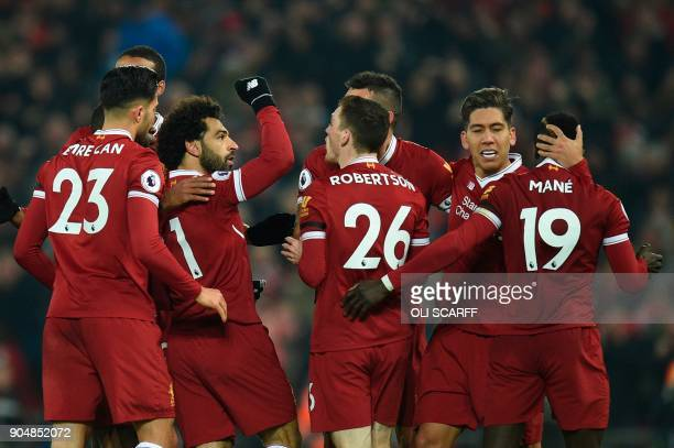 Liverpool's Egyptian midfielder Mohamed Salah celebrates scoring their fourth goal to make the score 41 with teammates including goalscorers...