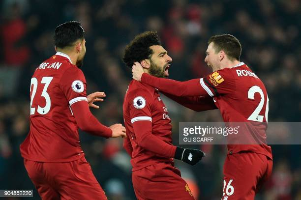 Liverpool's Egyptian midfielder Mohamed Salah celebrates scoring their fourth goal to make the score 41 with teammates Liverpool's Scottish defender...