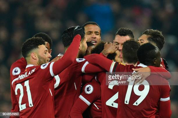 Liverpool's Egyptian midfielder Mohamed Salah celebrates scoring their fourth goal to make the score 41 with teammates during the English Premier...