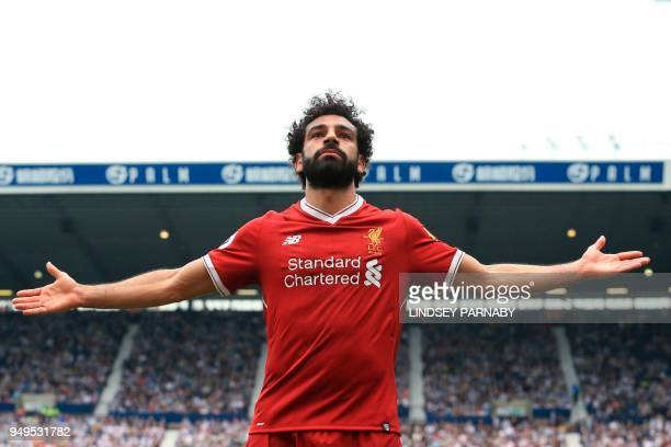Liverpool's Egyptian midfielder Mohamed Salah celebrates scoring their second goal during the English Premier League football match between West...