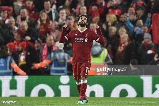 TOPSHOT Liverpool's Egyptian midfielder Mohamed Salah celebrates scoring their first goal during the UEFA Champions League first leg semifinal...