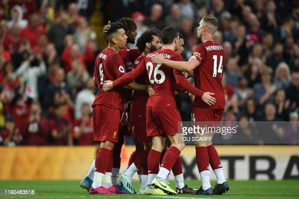 Liverpool's Egyptian midfielder Mohamed Salah celebrates with teammates after scoring the team's second goal during the English Premier League...