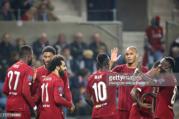 Liverpool's Egyptian midfielder Mohamed Salah celebrates with teammates after scoring a goal during the UEFA Champions League Group E football match...