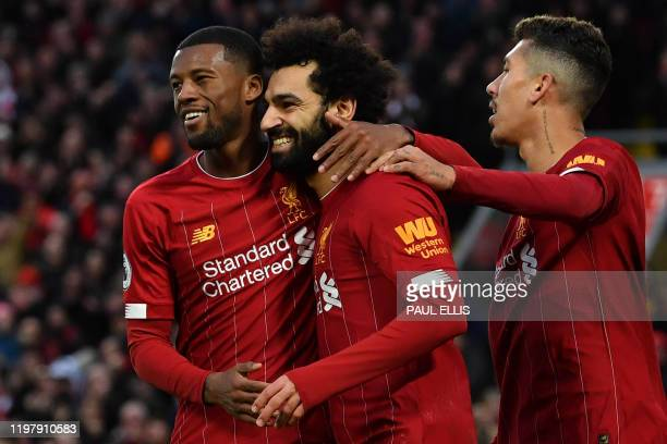Liverpool's Egyptian midfielder Mohamed Salah celebrates with teammates after scoring his team's third goal during the English Premier League...