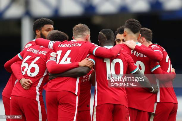 Liverpool's Egyptian midfielder Mohamed Salah celebrates with teammates after scoring his team's second goal during the English Premier League...