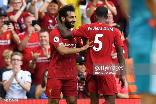Liverpool's Egyptian midfielder Mohamed Salah celebrates with Liverpool's Dutch midfielder Georginio Wijnaldum after scoring his second goal...
