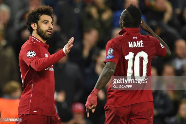 Liverpool's Egyptian midfielder Mohamed Salah celebrates with Liverpool's Senegalese striker Sadio Mane after scoring their second goal during the...