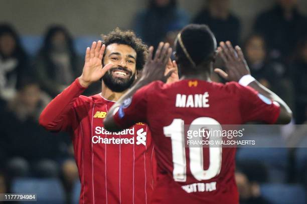 Liverpool's Egyptian midfielder Mohamed Salah celebrates with Liverpool's Senegalese striker Sadio Mane after scoring a goal during the UEFA...