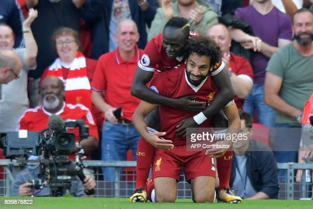 Liverpool's Egyptian midfielder Mohamed Salah celebrates with Liverpool's Senegalese midfielder Sadio Mane after scoring their third goal during the...