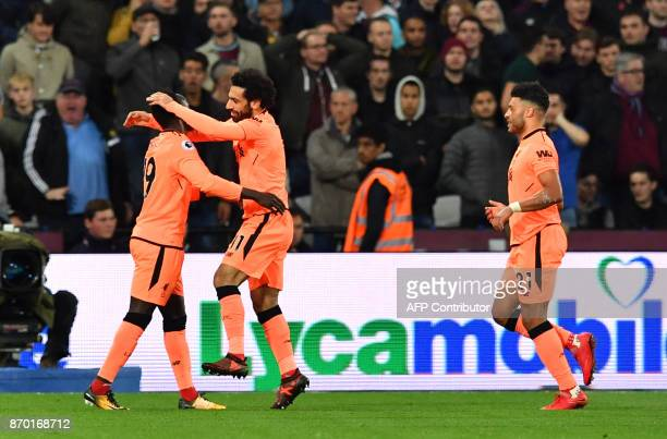Liverpool's Egyptian midfielder Mohamed Salah celebrates with Liverpool's Senegalese midfielder Sadio Mane after scoring during the English Premier...