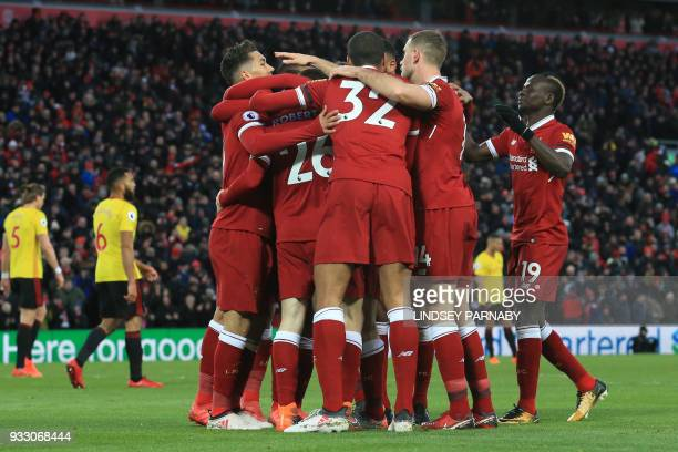 Liverpool's Egyptian midfielder Mohamed Salah celebrates with teammates scoring the team's second goal during the English Premier League football...