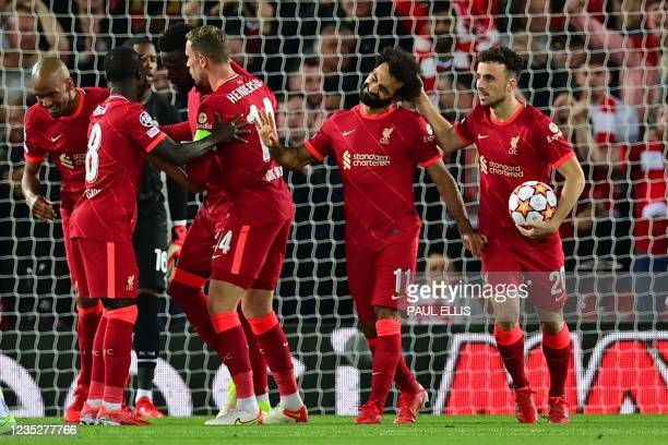Liverpool's Egyptian midfielder Mohamed Salah celebrates with team mates after scoring his team's second goal during the UEFA Champions League 1st...