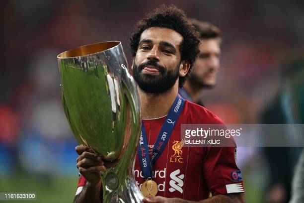 Liverpool's Egyptian midfielder Mohamed Salah celebrates with the UEFA Super Cup trophy after Liverpool won the UEFA Super Cup 2019 football match...