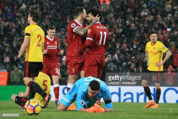 Liverpool's Egyptian midfielder Mohamed Salah celerates scoring the team's fifth goal past Watford's Greek goalkeeper Orestis Karnezis during the...