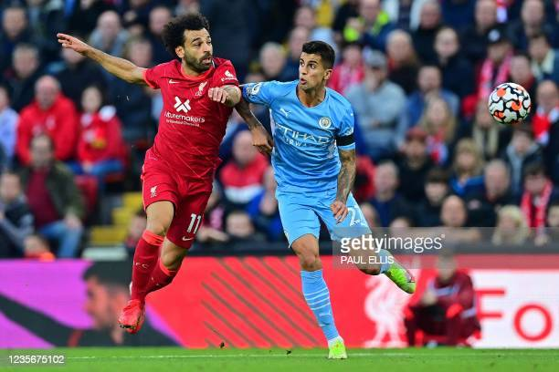 Liverpool's Egyptian midfielder Mohamed Salah challenges Manchester City's Spanish midfielder Rodrigo during the English Premier League football...