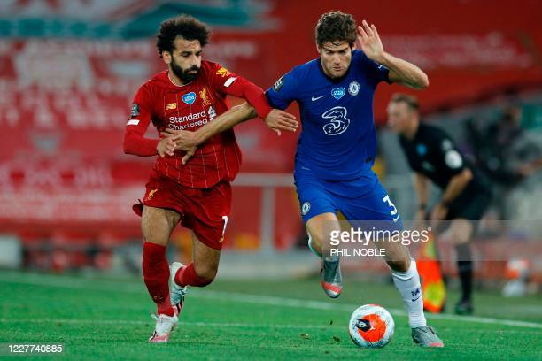 Liverpool's Egyptian midfielder Mohamed Salah chases Chelsea's Spanish defender Marcos Alonso during the English Premier League football match...